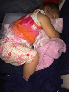 Abigail sleeping on plane
