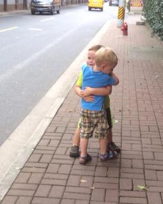 Asher and Jackson hug