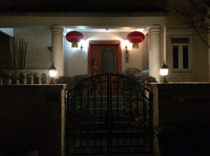 Folks hang red lanterns near their doorways and place greeting signs and paper cut-out flowers on windows and entryways.